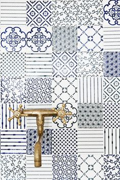 Love the look of mixed tiles and detailed tiles - Maybe not the colours but the patterns work well