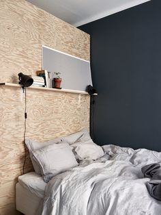 Plywood dividing wall in bedroom