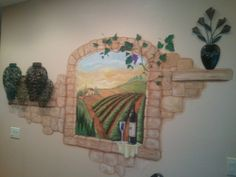 Tuscan theme kitchen/ a window looking out into the vineyard - the wine bottle has our last name and year we were married. Nice touch in personalizing it! Also created ledges made of brick giving it the appearance of shelves where I put metal deco. Of vases!