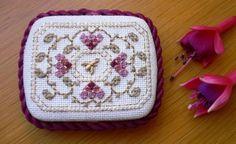 Pretty Lorri Birmingham design finished as a tin, cross stitch with Kreinik threads.