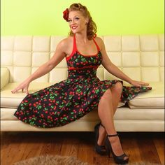 Rockabilly Dress! Cherry print.Price Firm! Print of red cherries, cherry blossoms and leaves on black background. Red satin halter neck straps. Sweetheart neckline. Slightly stretchy fabric (97% cotton, 3% elastane). First pic for show! See other pics for actual dress! Dresses