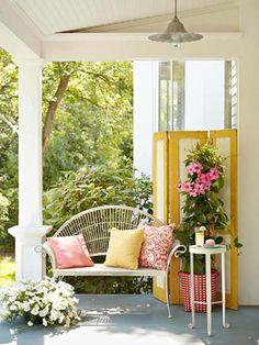 love the  soft colors  Go for cozy  Hinge together flea-market shutters to create a tall backdrop, such as this room divider, to make a lone bench feel sheltered and cozy