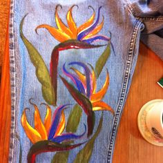Hand painted bird of praise on blue jeans