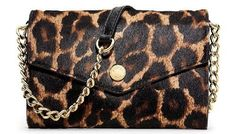 New Trending Clutch Bags: Michael Kors Cheetah Printed Calf Hair Electronics Phone Cross-body Bag. Michael Kors Cheetah Printed Calf Hair Electronics Phone Cross-body Bag  Special Offer: $189.00  322 Reviews Wrapped in cheetah printed calf hair with black leather trim and gold tone hardware. It has a flap top closure with front snap and an open slip pocket on the back. The leather...