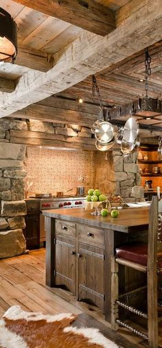 "Rustic Kitchen with Spinneybeck cowhide rug, Wood counters, Wolf 48"" Gas Range 4 Burners Infrared Dual Griddle, Breakfast bar"