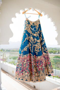 Bridal Lehenga - Blue Silk Lehenga with Gold Floral Patterned EMbroidery anf Multi- colored Embroidered Broad Border | WedMeGood #lehengas #indianwedding #indianbride #bridal #blue #gold