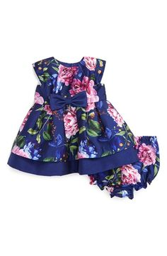 Free shipping and returns on Pippa & Julie Floral Print Cap Sleeve Dress (Baby Girls) at Nordstrom.com. Bright, cheery flowers tumble across the textured fabric of a cap-sleeve party dress accented by a pretty bow at the waist. The playfully pleated crinoline-lined skirt adds extra fullness to the tiered style.