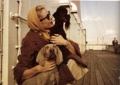 Grace Kelly on board the S.S Constitution bound for Monaco, April 1956. Grace is with her poodle, Oliver, and a Weimaraner, a wedding present from her brother  Photo by Howell Conant