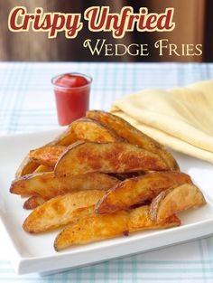 Unfried Crispy Wedge Fries - oven baked, crispy potato wedge fries made with less than a tablespoon of oil per person. Perfect with with our juicy Oven Baked Fried Chicken for a lower fat take-out alternative.