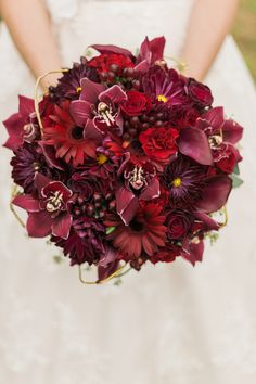 Beautiful Wedding Bouquet Comprised Of: Red Roses, Red Calla Lilies, Red Carnations, Red Cymbidium Orchids, Red Gerbera Daisies, Marsala Chrysanthemums, Burgundy Hypericum Berries, Dried Vine