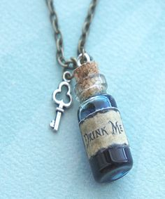 this necklace features an Alice in wonderland inspired drink me potion pendant. the glass vial/bottle pendant measures 2 cm tall and is securely attached to a bronze chain necklace that measures i Bottle Jewelry, Bottle Charms, Bottle Necklace, Padlock Necklace, Clay Charms, Alice In Wonderland Crafts, Wonderland Costumes, Alice In Wonderland Accessories, Alice In Wonderland Outfit