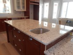 """My kitchen is finally getting there (in progress). Cambria Windermere quartz & 2 -tone Kitchen Craft cabinetry. Inexpensive cabinet pulls (from Home Depot) & knobs (from Lowe's). 5"""" Red Oak floors (to be stained with mini wax English Chestnut) and walls are Sherwin Williams On the Rocks (grey)."""