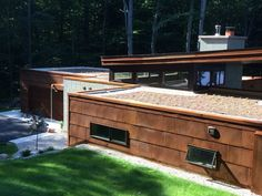 Present: Extensive green roof installed on a private residence in Honor, MI. Contact info@inhabitect.com for more information.