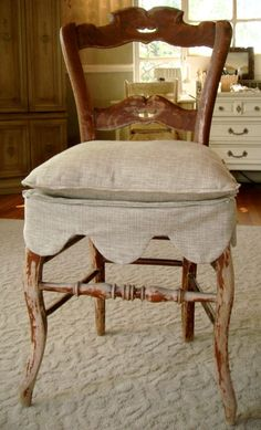 Slipcover - This looks easy enough to do by measuring the front and sides of the chair, determining the length of scallop then drawing it on paper before cutting.