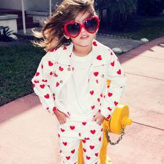 baby put on heart shaped sunglasses