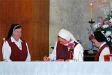 Sister Stephana Marbach, General Superior of the Sisters of the Incarnate Word and Blessed Sacrament of Victoria, Texas responds to Sister Patricia Marie's request to make vows; Sister Louise Marie requests to make perpetual vows; Bishop David Felhauer examines Sister Patricia Marie's readiness to make her first vows; Sister Patricia Marie signs her vows witnessed by Sister Stephana and Sister Amata Hollas, our General Secretary.