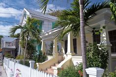 """Whitehead Street, Key West """"In Key West, It's all about Porches, Fences, Gates, Foliage, and Color. Old School Tropical Living"""""""