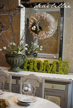 HOME... you could create the same way as the moss wreath project. Buy cardboard letters and cover.