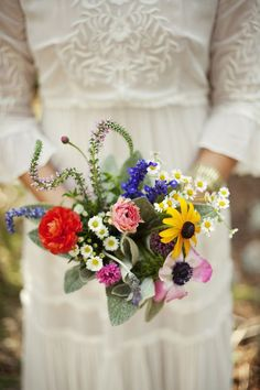 Simple, colourful bouquet of wildflowers. The colours of summer in this bouquet really make an impact. Perfect for a woodland wedding.