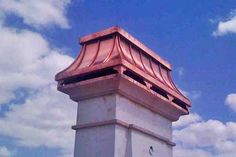 custom chimney cap design made of copper mounted on chimney top