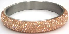 Pave Crystal Stainless Steel Slip-on Bangle With Light Beige Crystals with a Glittery Shine. 12mm Width. Pavel Steel. $24.00. Fits Average Women's Wrist. Gift Box Included. Stainless Steel. Light Beige Pave Crystal Around Entire Bangle. 12mm Width