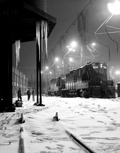 A train at a station in winter, date unknown.