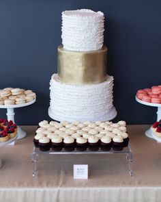 33 Romantic Wedding Cakes | Martha Stewart Weddings - Cocoa & Fig created this three-tiered cake using strawberry Champagne buttercream, sliced strawberry filling, and a vanilla buttercream exterior. The accent gold tier fits in perfectly between ruffled top and bottom tiers for a mix of modern and traditional.