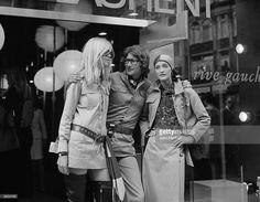 Yves Saint Laurent, French designer with two fashion models, Betty Catroux (left) and Loulou de la Falaise, outside his 'Rive Gauche' shop.