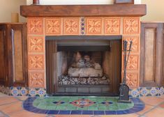 Fireplace  and hearth using Mexican tiles by kristiblackdesigns.com