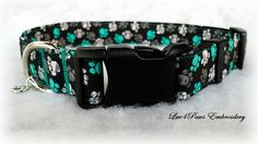 Adjustable collar with paw prints of turquoise green, white and grey on black, made with prewashed quality fabric, heavy weight interfacing and a curved nylon acetate buckle. A small charm is included. by Luv4PawsEmbroidery on Etsy