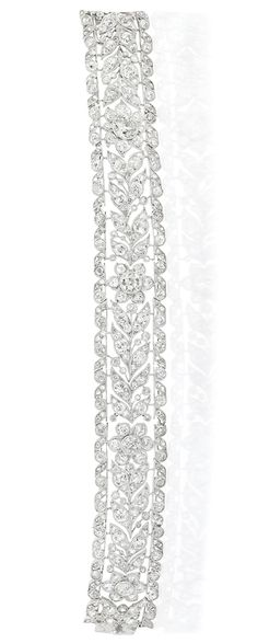 Belle Epoque Platinum and Diamond Bracelet   Of stylized garland motif, centering 4 old European-cut diamonds approximately 1.75 cts., set throughout with 201 old European, old-mine and single cut diamonds approximately 8.65 cts., accented by rose-cut diamonds, circa 1905, approximately 21 dwts. Length 6 1/2 inches.