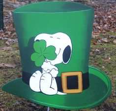 Snoopy hugging a clover   I made this and I made it to last   Made from 1/2 inch exterior plywood and attached with zinc straps and zinc screws