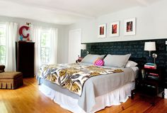 Check out the chalkboard paint headboard. Love a room that doesn't take itself too seriously.