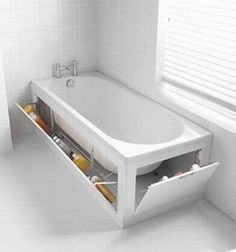 clever bathroom storage. better place for cleaning tools then under a sink where kids can get to. or other stuff anyway too cause who thinks to look under a tub lol