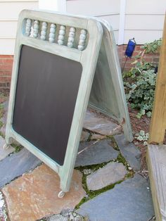The end panels of a vintage crib were used to make this darling message chalk board.