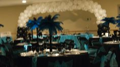 View of wedding reception June 1 2013 large balloon arch in background turquoise and black.