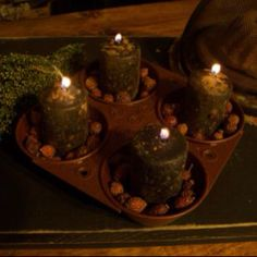 Rusted muffin tin with scented votives and rosebuds
