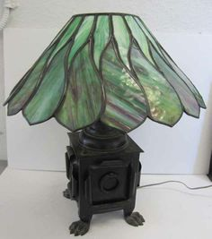 Rare Arts and Crafts American table lamp with iron base and great quality stained and leaded glass shade