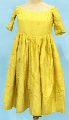 Child's dress, 18th century. Bright yellow moiré silk.