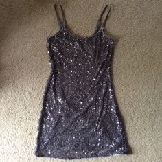 Silver Sparkle Tank This is a size Small Charlotte Russe silver sparkle tank top. It's only ever been worn once and is made of sheer material. It has a few strings on it that can be cut off. Comes from a smoke-free home. Feel free to comment if you have any questions! :) Charlotte Russe Tops