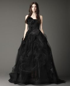 Strapless collapsed ballgown with peplum and sheer skirt with distressed organza, tulle and shadow lace tiers and washed flange detail