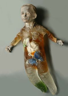 "Christina Bothwell , ""Floating"" - cast glass, raku clay and oil paint, 20 x 13 x 4 inches"