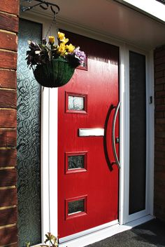 We finished this stunning modern installation, featuring our red composite door design: Seagram with side panels, textured glass, finished with a modern C Curve handle and patterned glass.