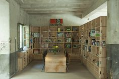 I like the crates stacked by the wall for storage in the basement.