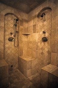 I like the two different areas the water can spray out of and that they are in individual arches that are set apart by the smaller diamond patterned tile.  bathroom ideas emmamcgrene.net