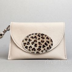 Wristlet made from off-white leather and leopard print decoration