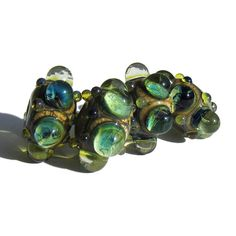 Handmade Lampwork Glass Beads Stormed Bubble Windows blue green s/4. $13.50, via Etsy.