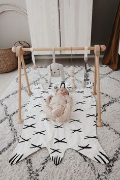 Wooden toys Activity Gym from Moulin Roty. Music bunny from Konges Sløjd. String wooden beads on a leather string. // The Way We Stroll Baby Needs, Baby Love, Baby Decor, Nursery Decor, Foto Baby, Baby Bedroom, Nursery Inspiration, Style Inspiration, Baby Play