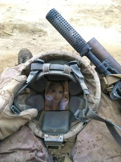My husband carried a picture of me && our dog in his helmet the entire time he was in Afganistan. Melted my heart! Xo