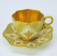 Antique jeweled Coalport cabinet cup and saucer